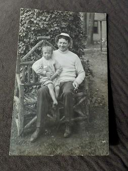 RPPC MAN HOLDING A YOUNG CHILD, GREAT ADIRONDACK CHAIR  1904